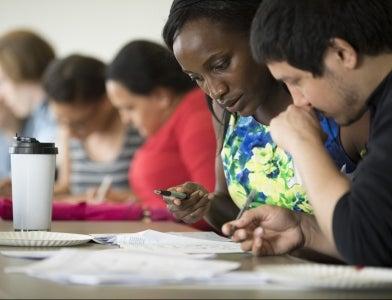 students conversing at table