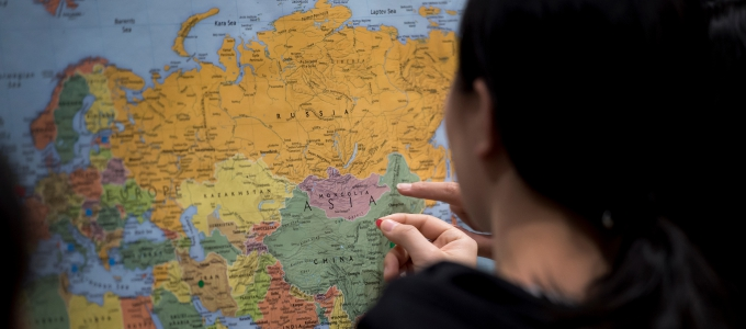 woman using world map